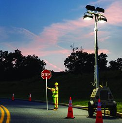 Traffic control professional being properly lit by floodlight tower