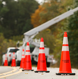 Infrastructure update: bucket truck in work zone—closeup of cones.