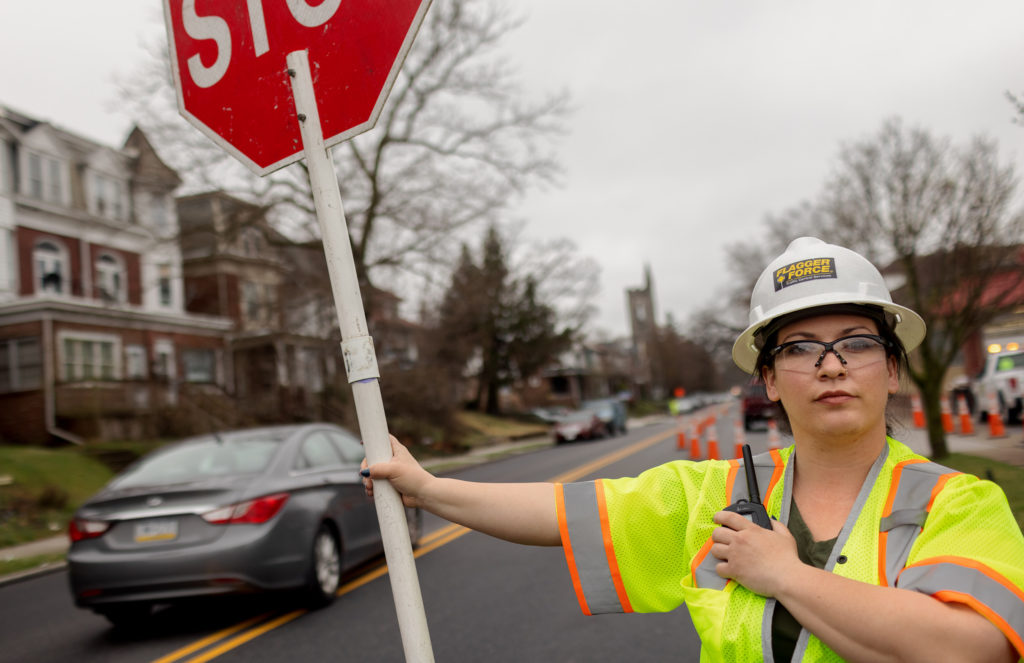 Jackie McVey actively flagging a work zone