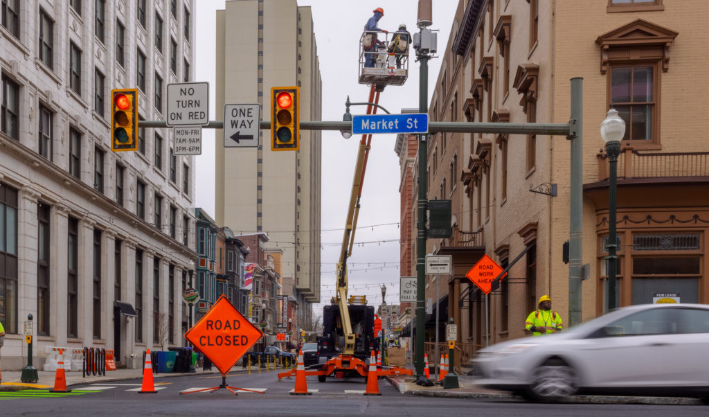 Work zone in Harrisburg, PA city with road closed signage