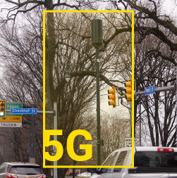5G tower highlighted by graphic in intersection