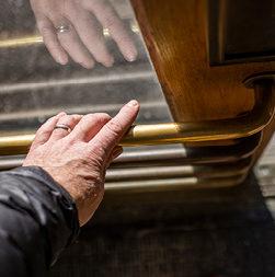 Hand on metal door handle