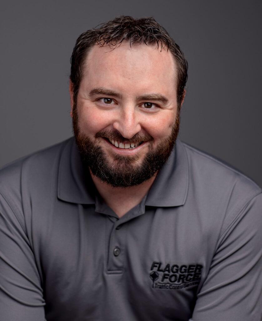Headshot portrait of Dan Jolly